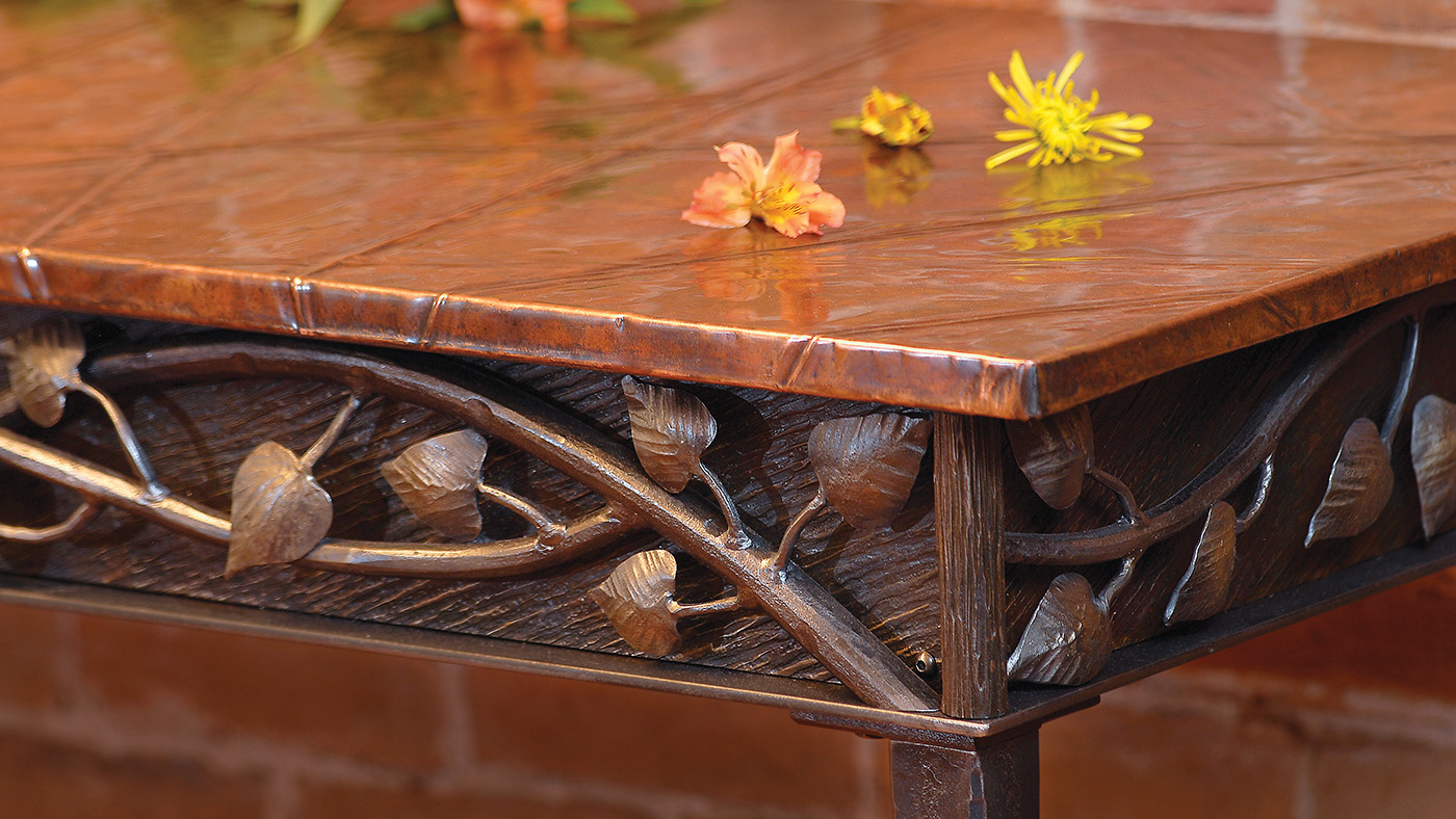 forged metal table with aspen leaves and branches